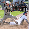 KEN YUSZKUS/Staff photo.     Danvers' Matt Andreas looks up in disbelief after sliding into home plate and declared out as Belmont's catcher Cal Christofori holds up the ball during the Belmont vs Danvers Division 2 North quarterfinal baseball playoff game. It would have been Danvers' 1st run.   06/06/16