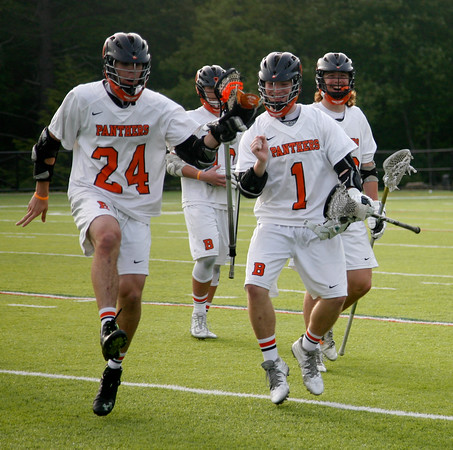 Beverly: During the North Division 2 playoff quarterfinal held at Endicott College on Saturday afternoon. Beverly beat Burlington 14-9. Beverly's Noah Kaplan, left, and Ewan Sellars, right, react to winning the game. Photo by Allegra Boverman