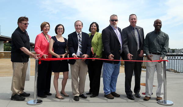 DAVID LE/Staff photo. From left, Councilor at Large Tom Furey, Councilor at Large Elaine Milo, Ward 2 Councilor Heather Famico, Paul Steadman, of Mass DOT, Mayor Kim Driscoll, Ward 5 Councilor Josh Turiel, State Representative Paul Tucker, and George Ford, a distant relative of John and Nancy Remond, after whom the park is named. 6/20/16.