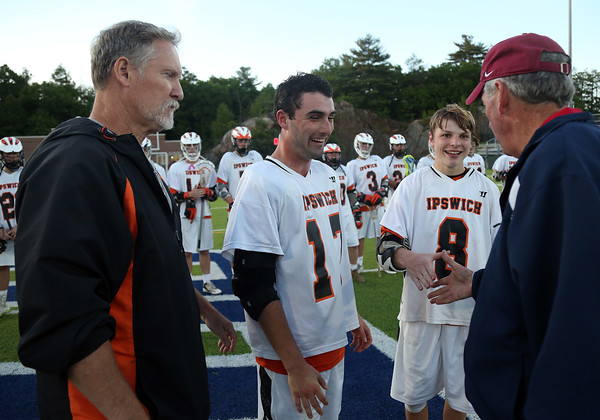 DAVID LE/Staff photo. Ipswich assistant coach Peter Ginolfi, and junior captains Charlie Gillis and Kilian Morrissey shake hands with tournament director Barry Haley. 6/10/16.