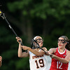 DAVID LE/Staff photo. Ipswich junior Julia Glavin (19) manages to keep the ball away from Melrose sophomore Lauren Pedrini (12). 6/7/16.