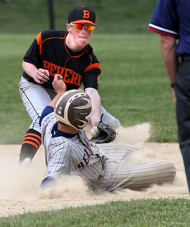 KEN YUSZKUS/Staff photo.     Belmont Paul Ramsey gets back to 2nd base as Beverly's Tim McCarthy tries for a tag during the Belmont at Beverly baseball state tournament game.     06/02/16