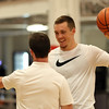 "DAVID LE/Staff photo. Former St. John's Prep and Notre Dame basketball standout Pat Connaughton, chats with a coach at his ""With Us"" basketball camp held at Danvers Indoor Sports. 6/28/16."