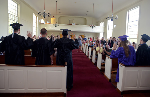 RYAN HUTTON/ Staff photo<br /> Then 2016 graduating class of Northshore Recovery High School turn to the applause of their family and friends after getting their diplomas at the school's commencement ceremony at the Second Congregational Church in Beverly on Wednesday night.
