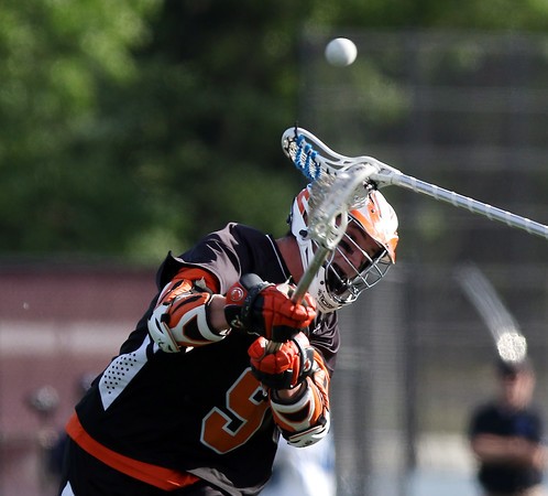 DAVID LE/Staff photo. Ipswich junior Tommy Ginolfi fires a shot against Dover-Sherborn on Tuesday afternoon. 6/14/16.