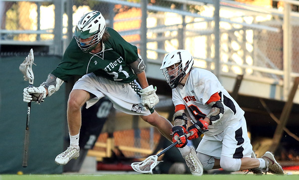 DAVID LE/Staff photo. Pentucket junior Liam Sheehy (21) evades a diving stick check from Ipswich junior captain Kilian Morrissey, right. 6/10/16.