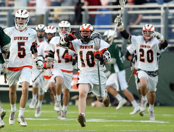 DAVID LE/Staff photo. Ipswich sophomore Pat Gillis (10) leads the charge towards sophomore goalie Aidan McAdams after the Tigers 7-4 win over Pentucket. 6/10/16.