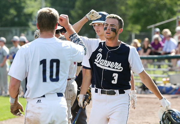 KEN YUSZKUS/Staff photo.     Danvers' Tim Unczur is greeted by his teamates after scoring Danvers' 1st run during the Belmont vs Danvers Division 2 North quarterfinal baseball playoff game.     06/06/16