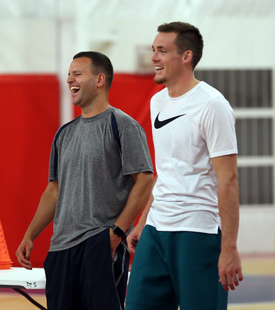 DAVID LE/Staff photo. Former St. John's Prep basketball standout Pat Connaughton, right, catches up with current head basketball coach John Dullea, at Connaughton's camp on Tuesday afternoon. Dullea was an assistant coach when Connaughton played for the Eagles, who now is a guard for the Portland Trailblazers. 6/28/16.