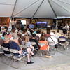 DAVID LE/Staff photo. People crowded under a tent on the grounds of the Henry Audesse estate on Larch Row in Wenham for an auction of many of the valuables that were inside the mansion. 7/1/16.