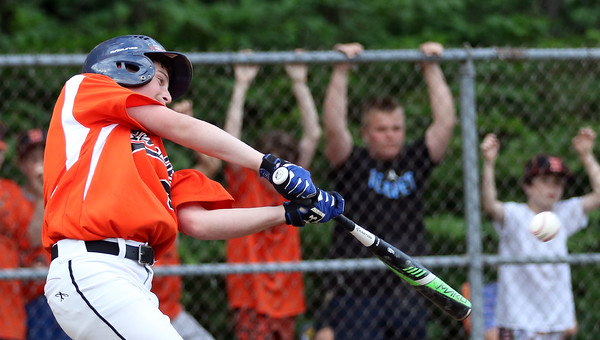 DAVID LE/Staff photo. Beverly's Charlie Mack launches a double to deep right field against Danvers in the first inning of play on Wednesday evening. 6/29/16.