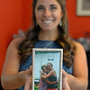 RYAN HUTTON/ Staff photo<br /> Beverly High senior Carly Blau is wearing a prom dress previously worn by her late friend Catherine Malatesta, who passed away from stage four cancer after wearing it herself. Blau is the fourth girl in their friend group to wear the dress to prom in Catherine's honor. Here she holds a photo of her and Catherine.