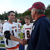 DAVID LE/Staff photo. Ipswich junior captain Charlie Gillis shakes hands with tournament director Barry Haley after the Tigers downed CAL rival Pentucket to capture the D3 North Title. 6/10/16.
