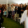 PAUL BILODEAU/Staff photo. Parents ready their recording devices as the soon to be graduates enter the tent during Hamilton-Wenham Regional High School's graduation ceremony in a tent on the football field at the school.