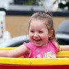 DAVID LE/Staff photo. Four-year-old Jacie Turco, of Salem, lets out a shriek of laughter while spinning around on a tea cup ride with her friend Layci Figueroa, at the annual carnival held at Saint Vasilios Greek Orthodox Church on Saturday morning. 6/11/16.
