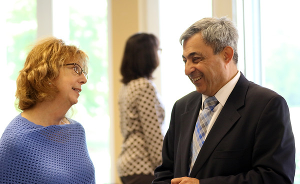 DAVID LE/Staff photo. State Representative Ted Speliotis, right, chats with Executive Director of the New England Homes for the Deaf Shelley Silverman, at a BBQ celebration to commemorate their 115th year. 6/9/16.