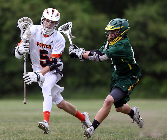 DAVID LE/Staff photo. Ipswich junior Dylan Perkins shields the ball with his body while being chased and stick checked by North Reading freshman Mark Potter, right, during the first period of play. 6/3/16.