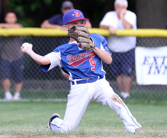 DAVID LE/Staff photo. Danvers shortstop Payton Palladino makes a sliding stab and throws to second to force a Beverly runner. 6/29/16.