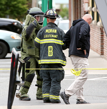 KEN YUSZKUS/Staff photo.    A suited up state bomb technician is about to enter Bertucci's Italian Restaurant on Enon Streeet in Beverly for the reported suspicious device found in the restaurant.     06/13/16