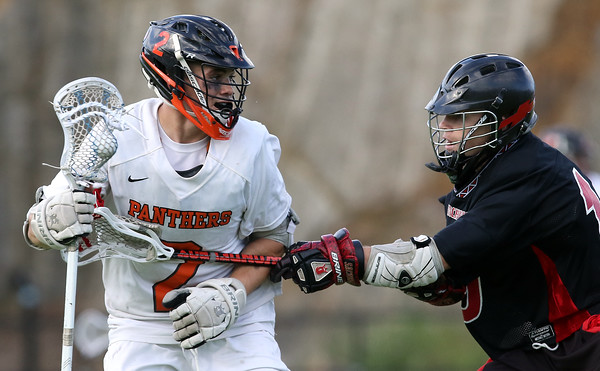 DAVID LE/Staff photo. Beverly junior Kyle Chouinard (2) tries to drive past Winchester's Andrew McCarthy (19). 6/10/16.