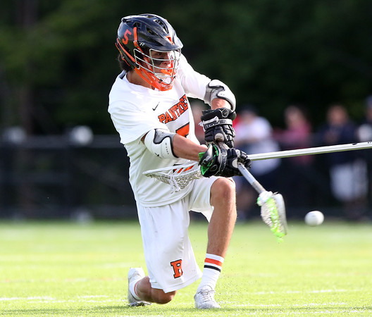DAVID LE/Staff photo. Beverly junior Sam Abate rifles a shot against Winchester on Friday afternoon. 6/10/16.