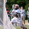 DAVID LE/Staff photo. Ipswich sophomore attack Pat Gillis (10) drives hard to the net and lines up a shot against North Reading in the D3 North quarterfinal. 6/3/16.
