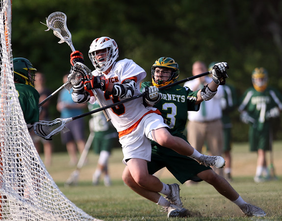 DAVID LE/Staff photo. Ipswich sophomore attack Kevin Swenson (3) falls towards the net and lines up a shot while being taken down by North Reading sophomore Jake Bedell (3). Swenson led the Tigers with 5 goals en route to a 11-7 win to advance to the D3 North semifinal. 6/3/16.