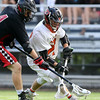 DAVID LE/Staff photo. Beverly senior attack Nick Dilusio (27) tries to scoop up a ground ball while battling with Winchester senior Daniel Bertochi (4). 6/10/16.