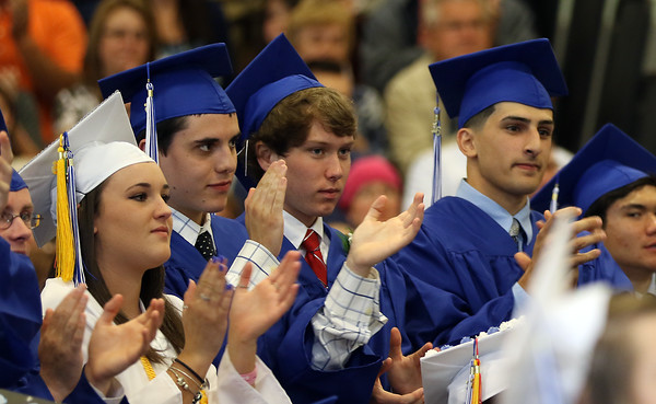 "DAVID LE/Staff photo. Danvers High School graduates give classmate Tre Crittendon a standing ovation after his speech ""Family"" on Saturday afternoon. 6/11/16."
