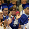 """DAVID LE/Staff photo. Danvers High School graduates give classmate Tre Crittendon a standing ovation after his speech """"Family"""" on Saturday afternoon. 6/11/16."""