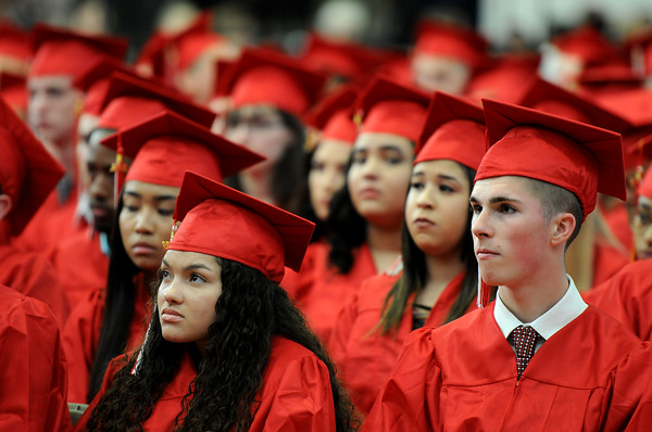 PAUL BILODEAU/Staff photo. Students listen to Mayor Kim Driscoll deliver her speech during Salem High School's graduation ceremony in the high school's field house.