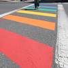 KEN YUSZKUS/Staff photo.    Denis Castleton of Salem walks in the newly painted rainbow crosswalk across Washington Street in Salem.      06/17/16