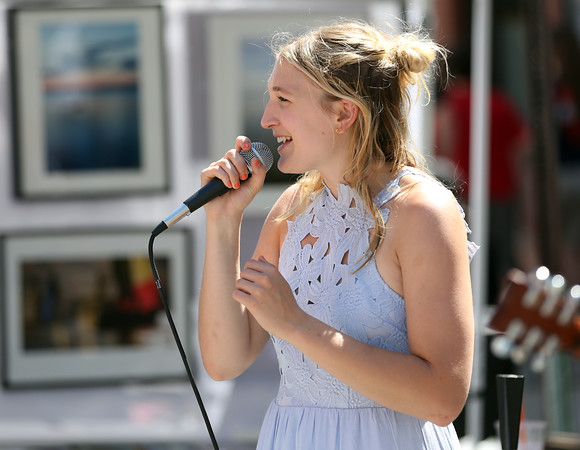 DAVID LE/Staff photo. Katie Donnelly, singer for the band Now For Ages, performs along Cabot Street in Beverly as part of the annual Beverly Arts Fest. 6/18/16.