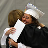 DAVID LE/Staff photo. Danvers graduate Madison Mucci hugs principal Susan Ambrozavitch after receiving her diploma. 6/11/16.