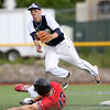 DAVID LE/Staff photo. Danvers senior shortstop Andrew Olszak leaps clear of sliding North Andover senior Joseph Kramer as he slid in to try and break up a double play. 6/9/16.