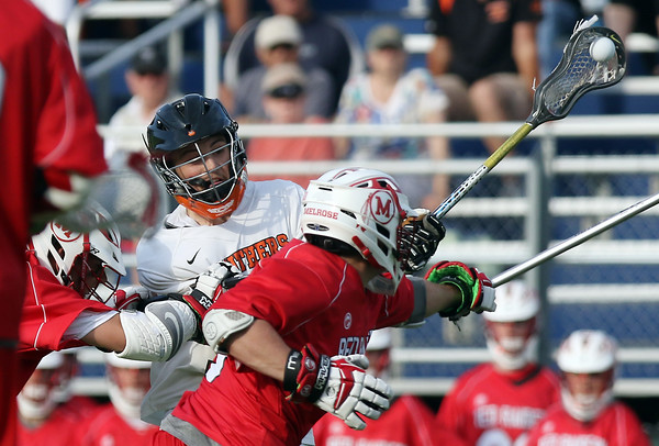 DAVID LE/Staff photo. Beverly senior attack Jordan Rawding rifles home a goal while being pressured by two Melrose players on Tuesday afternoon. 6/7/16.