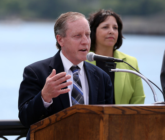 DAVID LE/Staff photo. Paul Steadman, of Mass DOT, speaks to a large crowd gathered for a ribbon cutting on the new Salem Harbor Boardwalk. 6/20/16.