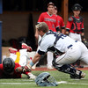DAVID LE/Staff photo. Danvers junior catcher Matt Andreas, right, lunges back towards the third base line and tags out North Andover junior Drew Finn as he tried to score the go-ahead run in the top of the 4th inning of play. 6/9/16.