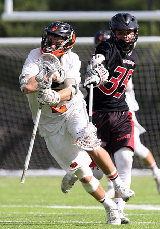 DAVID LE/Staff photo. Beverly junior Kyle Chouinard, left, avoids Winchester senior Dan O'Connell (35), but not after he got whacked over the head by O'Connell's stick. 6/10/16.