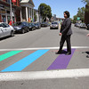 KEN YUSZKUS/Staff photo.    Mayor Kim Driscoll and Ward 2 Councillor Heather D'Amico walk in the newly painted rainbow crosswalk across Washington Street in Salem.      06/17/16