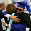 DAVID LE/Staff photo. Danvers graduate Danny Lynch hugs principal Susan Ambrozavitch after receiving his diploma. 6/11/16.