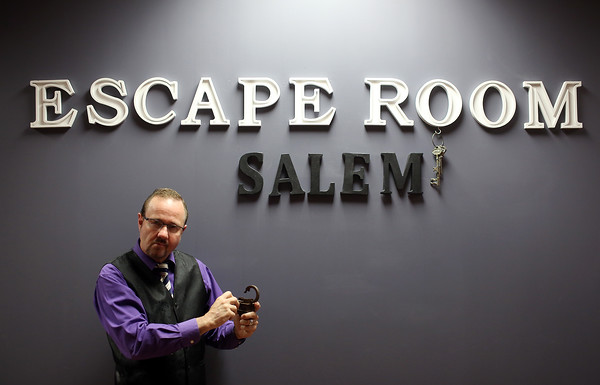 DAVID LE/Staff photo. John Denley, _______ has opened a new Escape Room location inside the Museum Place Mall in Salem. As part of the Escape Room mission, participants must solve riddles, unlock keys, and eventually stop a zombie apocalypse in under an hour. 6/10/16.