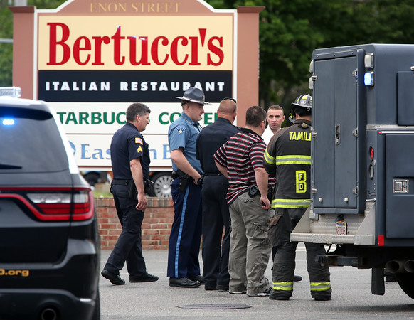 KEN YUSZKUS/Staff photo.    Police gather outside Bertucci's Italian Restaurant on Enon Streeet in Beverly for the reported suspicious device found in the restaurant.     06/13/16