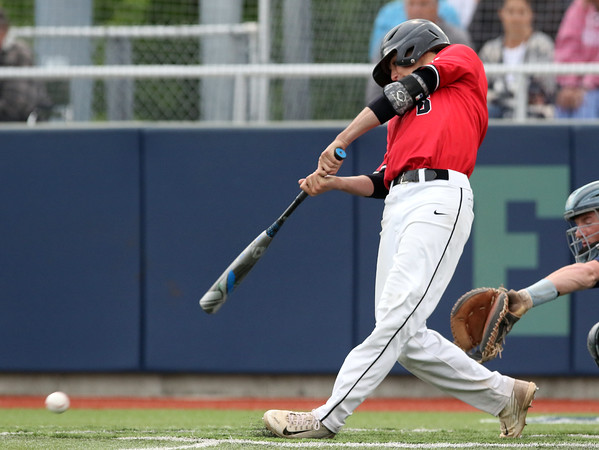 DAVID LE/Staff photo. North Andover senior Brendan Parisotto lines a single in the top of the 7th inning of play. 6/9/16.