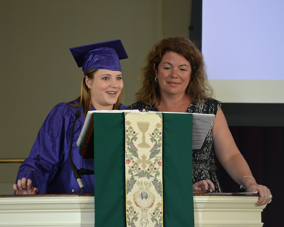 RYAN HUTTON/ Staff photo<br /> Northshore Recovery High School graduate Elizabeth Boggs gives her graduation speech as school director Michelle Lipinski stands at her side during the school's commencement ceremony at the Second Congregational Church in Beverly on Wednesday night.