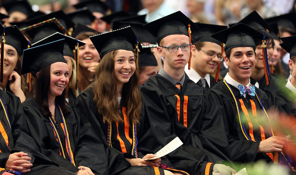 DAVID LE/Staff photo. Beverly High School graduates listen to speeches at graduation on Sunday afternoon. 6/5/16.