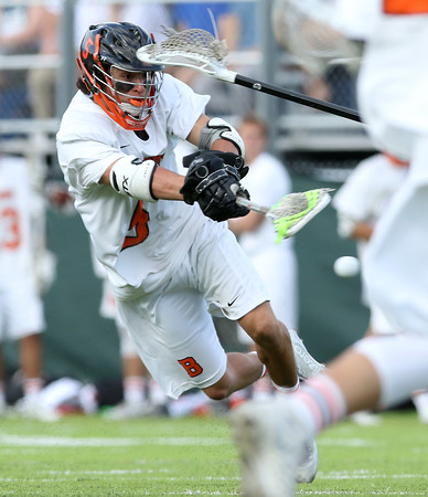 DAVID LE/Staff photo. Beverly junior midfielder Sam Abate rifles a shot on net against Winchester on Friday afternoon. 6/10/16.