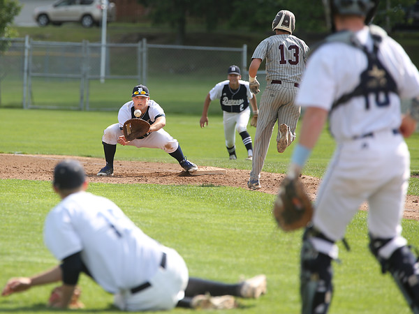 KEN YUSZKUS/Staff photo.     Danvers' pitcher Andrew Olszak, bottom left, threw to 1st baseman Zach Dillon after picking up the bunt and got Belmont's Dave Bailey out during the Belmont vs Danvers Division 2 North quarterfinal baseball playoff game.     06/06/16