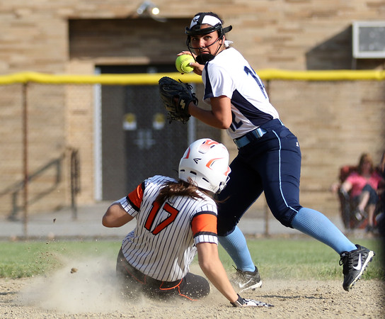 DAVID LE/Staff photo. Peabody shortstop Alyssa Alperen steps around sliding Beverly senior Ally Cabral and fires to first to complete a double play. 5/25/16.