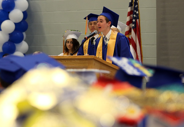 """DAVID LE/Staff photo. Danvers senior class Treasurer Samuel Montanari delivers part of the Class Officers' joint speech """"Qualities That Define Us"""" at graduation on Saturday afternoon. 6/11/16."""